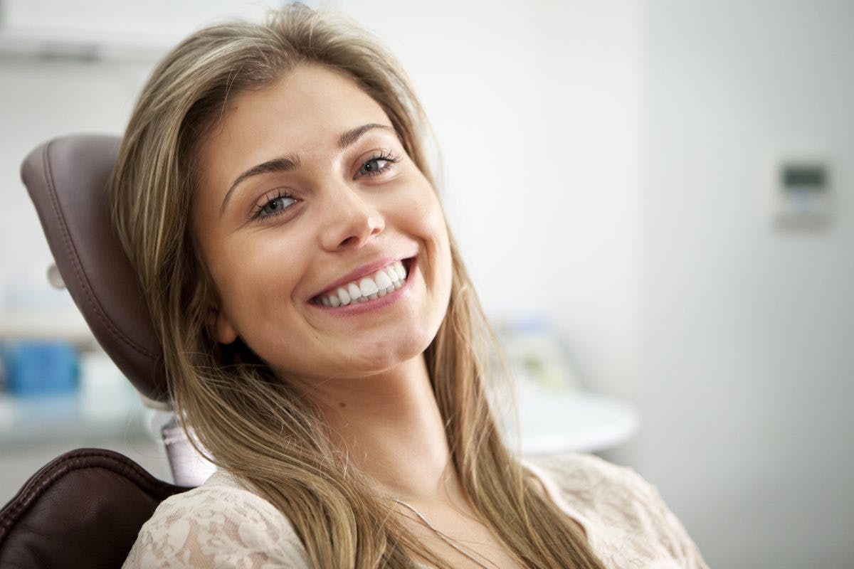Female Patient In Chair Smiling I Stock 133758501