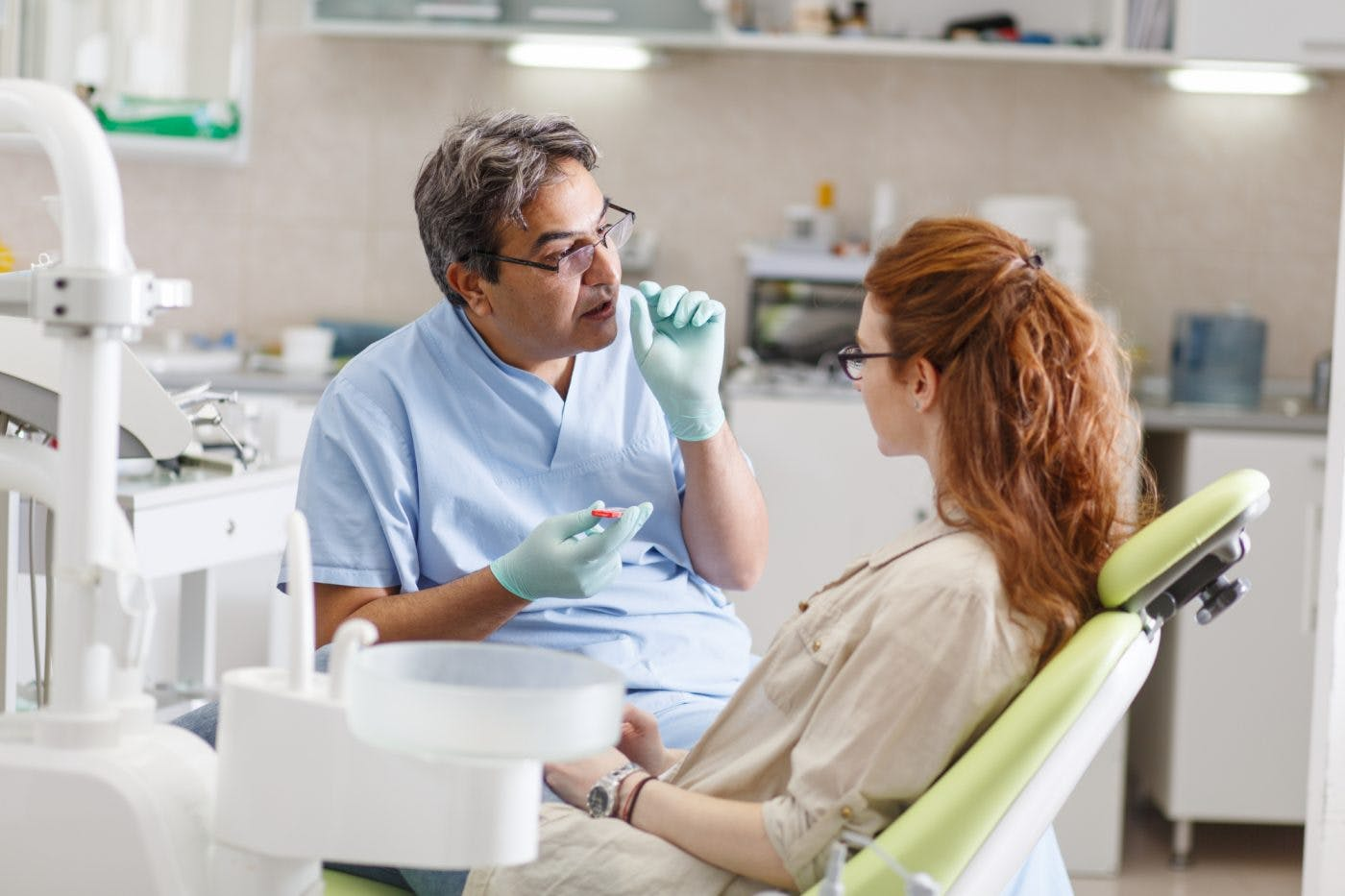 50S Male Dentist And 20S Patient Shutterstock 512653249