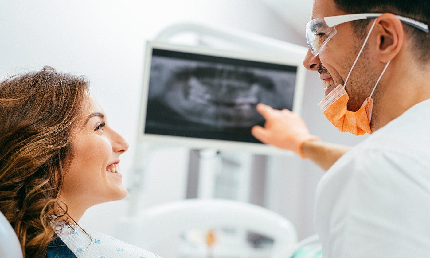 Dentist Pointing At Scan